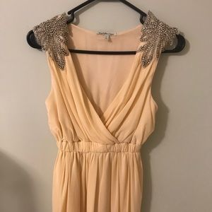 Flowy Ivory Dress with Shoulder Embellishment